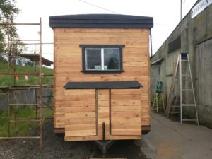 The small shed on the back contains a water heater and filtration system.
